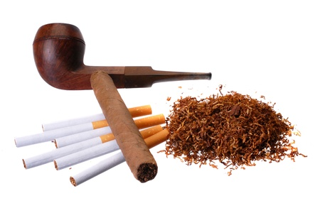 Tobacco. Cigar, cigarettes, pipes and a handfull of tobacco Stock Photo