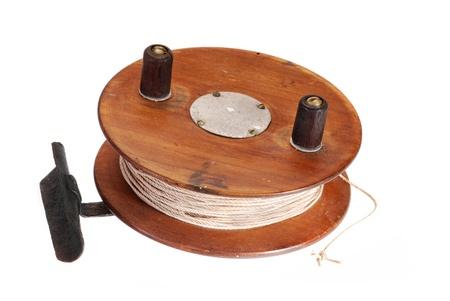 Old fishing reel of wood. Stock Photo