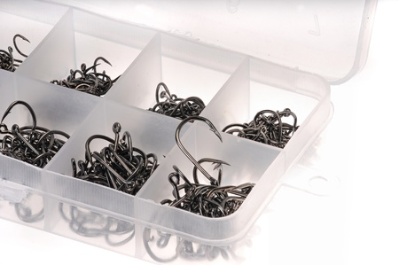 Box with different sizes of black fishing hooks photo