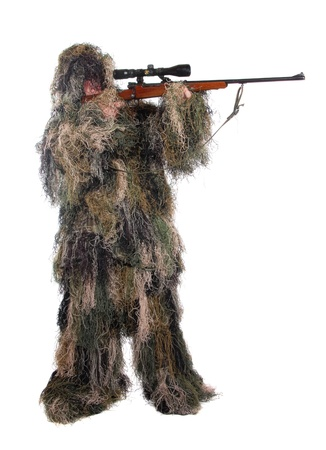 Ghillie suit. Hunter with a rifle dressed in a ghillie suit