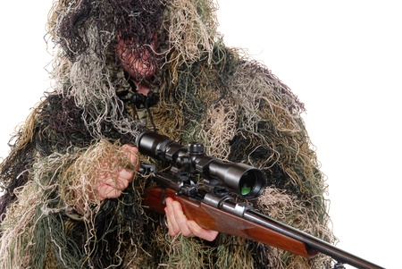 sniper rifle: Ghillie suit. Hunter with a rifle dressed in a ghillie suit.