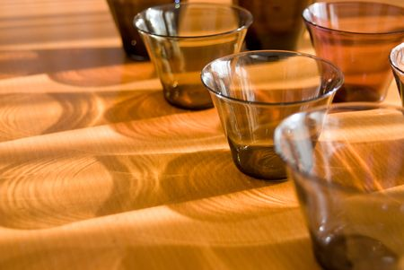 shadowed: Shadowed glasses on the wood table. Stock Photo