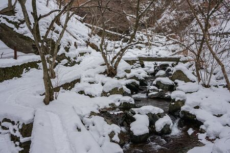 Trekking the snowy mountains for beautiful waterfalls