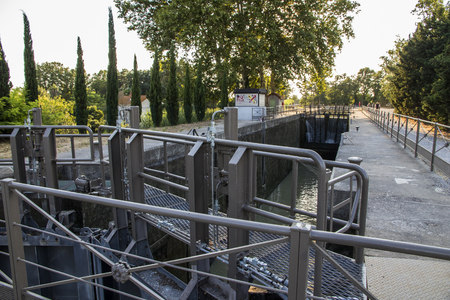 One of the locks in Beziers, France, that helps the Canal du Midi to cross over the river Orb. A world heritage site since 1996 Editorial