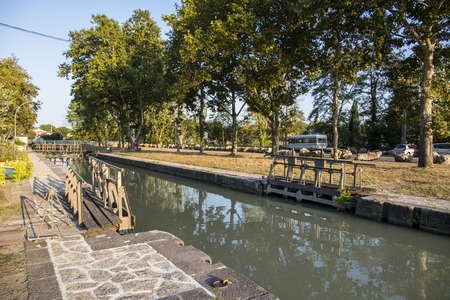 One of the locks in Beziers, France, that helps the Canal du Midi to cross over the river Orb. A world heritage site since 1996 Stock Photo