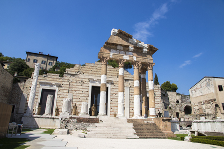 The ruins of the Capitolium or Temple of the Capitoline Triad in Brescia, Italy, main temple in the center of the ancient Roman town of Brixia