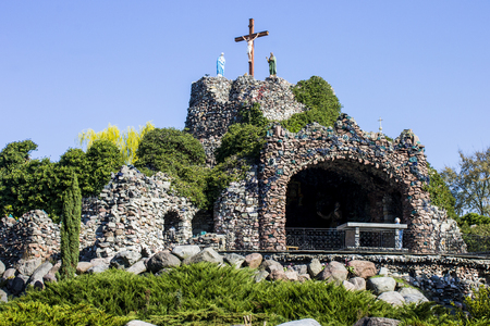 The Golgotha, a 25-meter high stone hill in Lichen Stary with a cross and figures of Mary and John the Apostle and also with Stations of the Cross.