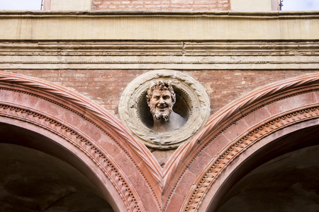 The face of the devil in one of the palaces of Piazza Santo Stefano, called L inferno a casa Editorial