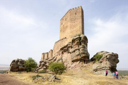 The Castillo de Zafra, a 12th-century castle built on a sandstone outcrop in Sierra de Caldereros, Campillo de Duenas, Castilla La Mancha, Spain Editorial