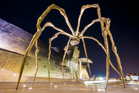 Maman, a sculpture of a spider by Louise Bourgeois that rests in front of the Guggenheim Museum Bilbao, Spain Editorial