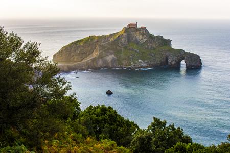 Sunset at San Juan de Gaztelugatxe, a famous peninsula in the coast of Bermeo, Basque Country, Spain Stock Photo