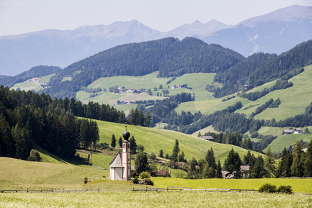 The St. Johann in Ranui chapel in Villnoss (Val di Funes). South Tyrol, northern Italy Stock Photo