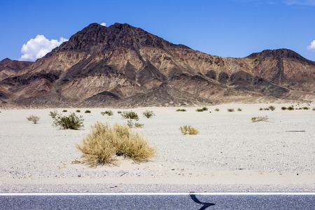 One of the roads that crosses Death Valley National Park, a desert valley located in Eastern California and one of the hottest places in the world