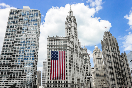 River Plaza, Wrigley Building with large American flag, and Tribune Tower. Chicago, Illinois