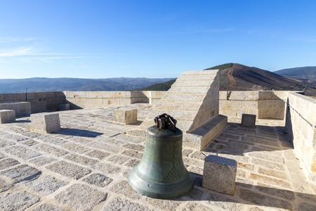 A bell at the top of the keep of the Castelo de Monterrei, a 12th-century castle near the town of Verin, Galicia, Spain