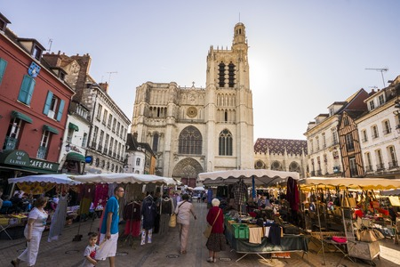 The Cathedral of Saint Stephen of Sens, a Catholic cathedral in Sens in Burgundy, eastern France, with the market square full of people Editorial