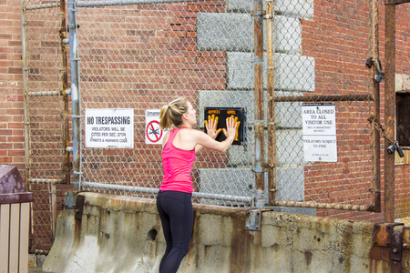 Female runner doing a high-five with the Hoppers Hands sign in Fort Point, San Francisco, California