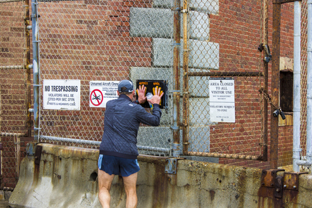 Male runner doing a high-five with the Hoppers Hands sign in Fort Point, San Francisco, California Editorial