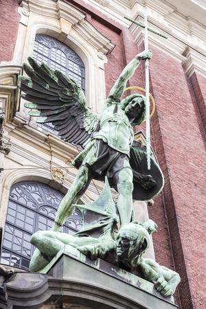 Hamburg, Germany. St. Michael's Victory over the Devil, sculpture above the main entrance of St. Michael's Church (Hauptkirche Sankt Michaelis)