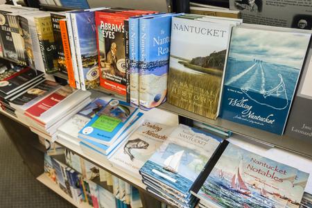 Books about Nantucket island in a shelf inside Mitchells Book Corner, a bookshop in Nantucket town, Massachusetts