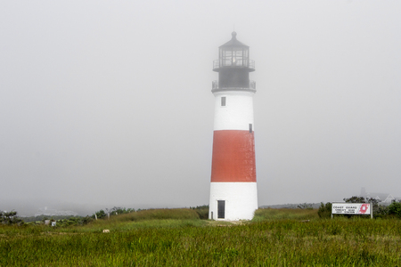 Nantucket, Massachusetts. The Sankaty Head Light, a White with red band midway lighthouse built in brick and granite in 1850 near the village of Siasconset in Nantucket island