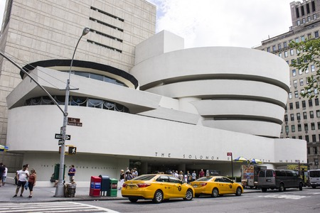 New York City. The Solomon R. Guggenheim Museum, an art museum located at Fifth Avenue in the Upper East Side neighborhood of Manhattan. Built in 1959 and designed by Frank Lloyd Wright