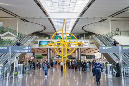 Swords, Ireland. Interior view of the main hall of Dublin Airport (Aerfort Bhaile Atha Cliath), crowded with people