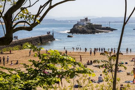 Santander, Spain. Views of the crowded Playa de los Peligros beach and the Isla de la Torre (Tower Island) Editorial