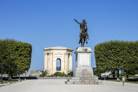 Monuments of the Promenade du Peyrou in Montpellier, France. Aqueduc Saint-Clement (acueduct), Monumental chateau deau (water tower) and Equestrian statue of Louis XIV of France Editorial