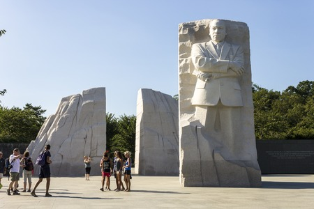 Washington, D.C. The Martin Luther King Jr. Memorial in West Potomac Park next to the National Mall, a granite statue of Civil Rights Movement leader Martin Luther King by sculptor Lei Yixin Редакционное