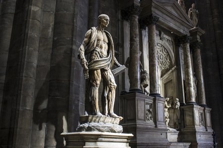 Statue of St Bartholomew by Marco DAgrate, made around 1562 and placed in the right transept of Milan Cathedral. He was skinned alive and then beheaded Editorial