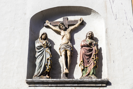 Trier, Germany. Christ on the Cross with the Virgin and Saint John in St. Gangolfs church