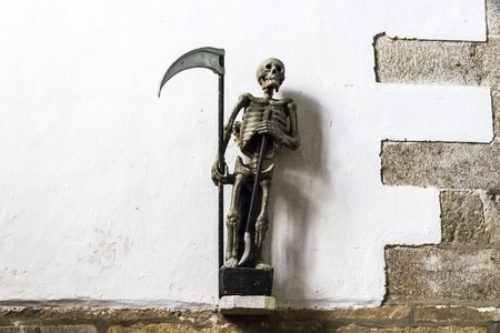 Ploumilliau, France. Statue of the Ankou, a 16th century personification of death at the Church of Saint Milliau