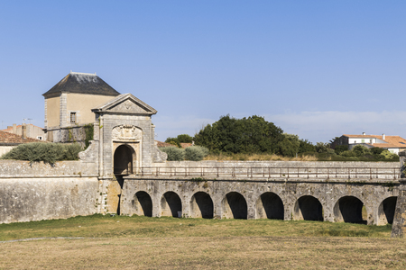 Saint-Martin-de-Re, France. The porte des Campani, ditch and fortifications at the entrance of the Old Town Stock Photo