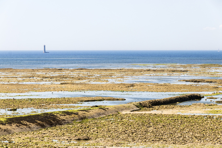 Saint-Clement-des-Baleines, France. Views of the sea from the Phare des Baleines, with the stone beach and the large subterranean pipes Stock Photo