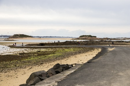 Carantec, France. The submersible passage to Ile Callot, a tidal island only accesible al low tide in the coast of Brittany (Bretagne) Stock Photo