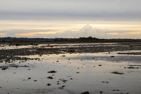 Carantec, France. Views of the Bahie de Morlaix (Morlaix Bay) and the city of Saint-Pol-de-Leon at sunset, Brittany (Bretagne) Stock Photo