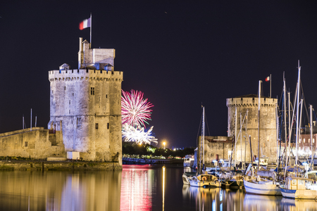 La Rochelle, France. Fireworks of La Palmyre of Aug 5 2018 at the Old Harbor (Vieux Port), with the La Chaine and Saint Nicolas Towers Stock Photo