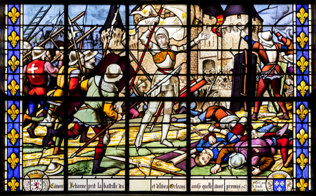 Fougeres, France. Stained glass window representing Joan of Arc after the Siege of Orleans, Eglise Saint-Sulpice church 新闻类图片