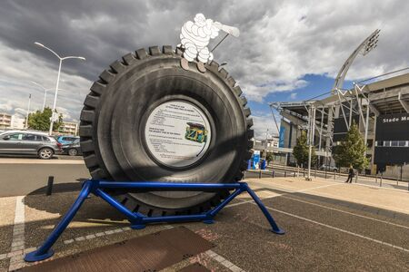 Clermont-Ferrand, France. Figure of Bibendum (Michelin Tyre Man), at the L'Aventure Michelin museum over the largest tyre in the world