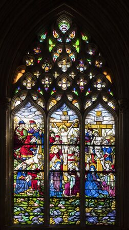 Batalha, Portugal. Stained glass window with stages of the Passion of Christ. Jesus is nailed to the cross, dies, and is taken down