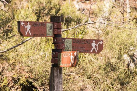 Asturias, Spain. Hiking trail signs at the Muniellos Nature Reserve (Reserva natural integral), area of woodland along the river Muniellos-Tablizas