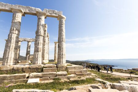 Sounion, Greece. The Temple of Poseidon, an Ancient Greek temple and one of the major monuments of the Golden Age of Athens built at Cape Sounion 스톡 콘텐츠 - 132982573