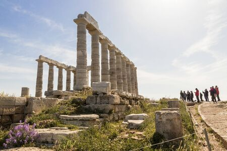 Sounion, Greece. The Temple of Poseidon, an Ancient Greek temple and one of the major monuments of the Golden Age of Athens built at Cape Sounion 스톡 콘텐츠 - 132982574