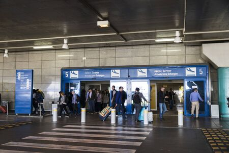 Athens, Greece. People entering and leaving the departures terminal of Athens International Airport Eleftherios Venizelos (ATH)