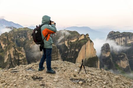 Kalabaka, Greece. A photographer taking pictures of the monasteries of Meteora in the early morning