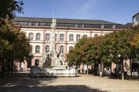 Trier, Germany. The Sankt Georgsbrunnen (Saint George Fountain) in Kornmarkt, with the Posthof in the background