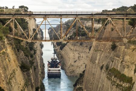 The Corinth Canal, Greece, a channel done in 1893 that cuts the narrow Isthmus of Corinth and separates the Peloponnese from the Greek mainland