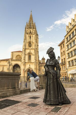 Oviedo, Spain. Statue of La Regenta, from the realist novel by Spanish author Leopoldo Alas Clarin, in front of the Cathedral