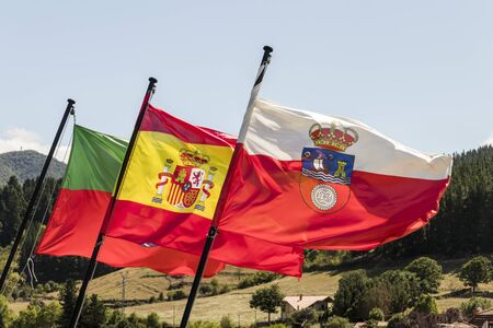 Potes, Spain. Flags of Potes, Spain and Cantabria waving from the Torre del Infantado tower